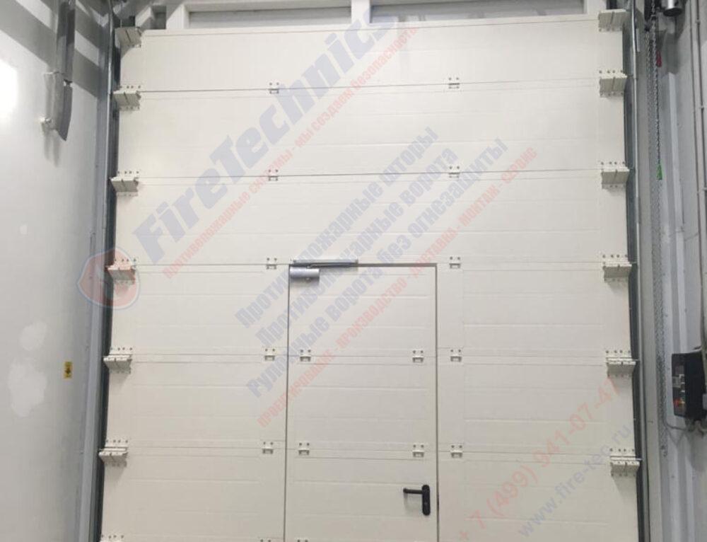 Секционные противопожарные ворота EI60 с калиткой в Казахстане