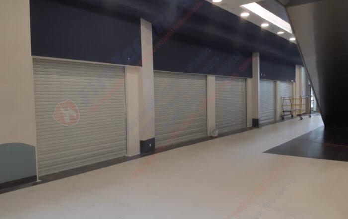 Ворота FireTechnics типа Firerollgate EI60 (FRG) противопожарные (предел огнестойкости EI60), стальные, рулонные, глухие, автоматические (с электроприводом)